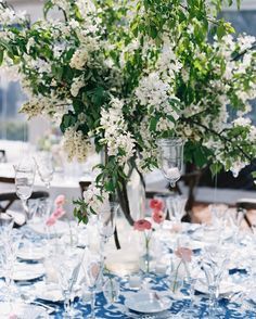 Other tables were anchored by large arrangements of flowering white branches.