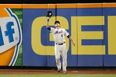 CrowdCam Hot Shot: New York Mets center fielder Matt den Dekker makes a catch for an out during the ninth inning against the Miami Marlins at Citi Field. Mets won 4-3. Photo by Anthony Gruppuso