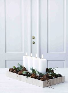 christmas inspiration A Minimalist Christmas: 12 Understated (But Still Gorgeous) Decorating Ideas Minimalist/Maximalist Christmas Candle Decorations, Scandinavian Christmas Decorations, Advent Candles, Christmas Candles, Winter Decorations, Modern Christmas Decor, Christmas Design, Christmas Decorations For Apartment, Apartment Holiday Decor