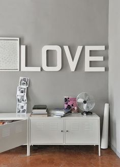 Big decorative letters on a grey wall