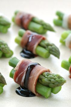 Asparagus bundle -- I'd use either parma ham, prosciutto, or super thin sopressata. Blanch asparagus. Wrap and throw under the broiler for a few minutes. Drizzle with a balsamic glaze and top with lemon zest for tang and a pop of color!