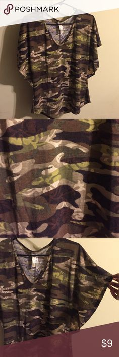 ✨Camo colored nice top Very pretty camo top with flowy sleeves as seen in the last picture.  NOT REAL BRAND ONLY for views. 🌻Make Offers🌻 Charlotte Russe Tops