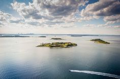 Yankee Magazine - Explore Boston Harbor Islands:  Fort George makes for a dramatic view from the air with the Boston skyline in the distance.