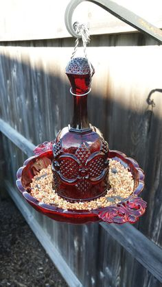 Red Viking and Avon glass hanging bird feeder - pretty
