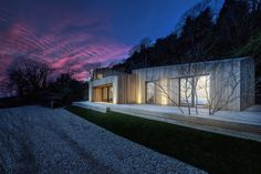 Modern cabin home with wood slat exterior and large, floor to ceiling windows