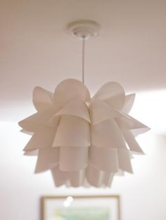 Modern Possini Euro Design flower pendant is a classic. See the unexpected room w/ this fixture.--> http://www.hgtv.com/kids-rooms/an-eclectic-colorful-boys-room/pictures/page-7.html?soc=pinterest