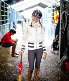 Paula Matute in Pikeur coat, Pikeur candella breeches, and Petrie superior classic boots in cognac.
