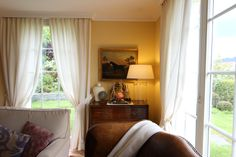 ...a corner in the living room, where a naive painting auctioned from Sworders in Stansted Mountfitchet finds a place.