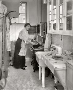 "Margarete's Kitchen: 1914. March 2, 1914. ""Margarete Ober."" The Metropolitan Opera mezzo-soprano with a nice rib roast. 8x10 glass negative, G.G. Bain Collection. Nice details of kitchen furnishings."