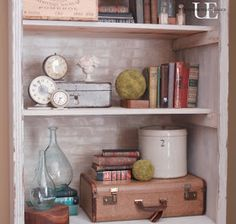Lots of my favorite collections...together in one place...books, suitcases, and vintage clocks!
