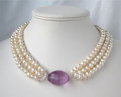 Freshwater Pearl Necklace, Lavender Crystal, 3 Strand Ivory Pearl Necklace, Silver, Handmade, Laurie. $60,00, via Etsy.