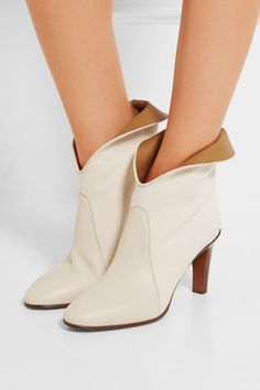 Heel measures approximately 90mm/ 3.5 inches Off-white canvas and leather Pull on Made in Italy