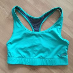 Reversible sports bra Reversible sports bra. The teal side is a little more green than the pic is showing. Super cute and in perfect condition. Worn only once! Champion Intimates & Sleepwear Bras