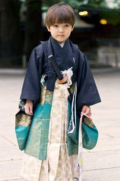 Boy dressed in ceremonial kimono, hakama and sword.  Japan Shichigosan