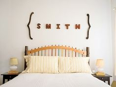 Letters on wall above bed