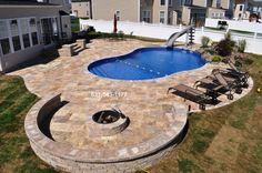 Free Form Vinyl-lined Pool & Slide Designed by Gappsi This private residence located on Long Island, NY features the design & installation by Gappsi Group. The image above pictures the comp...
