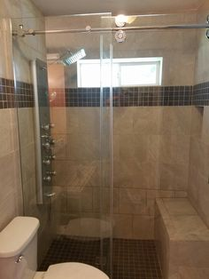 We put the window in installed the glass doors this is a tiled shower with bench seat and Schluter waterproofing system