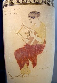 Greek vase with muse playing the phorminx, a type of lyre