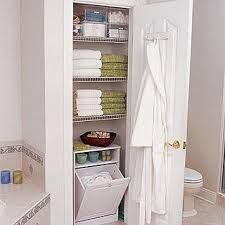 bathroom closet ideas. Under The Table and Dreaming  Ideas Inspiration for Organizing Putting Together a Linen Closet bathroom Makeover Modern Bathroom Storage Packed Small Smart