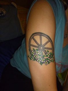 """I made it down the coast in 17 hours,  pickin' me a bouquet of dogwood flowers  and I'm a-hopin' for Raleigh so I can see my baby tonight,  so rock me mama like a wagon wheel….""    by Jason at California Tattoo in Savannah, GA"