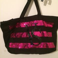 Sale Victoria's Secret travel bag NWOT Victoria's Secret brushed cotton travel bag in black & fuchsia with sparkles, fully lined zippered closing which is different than other totes this one is sturdy ! Great for travel carry on or beach or shopping Victoria's Secret Bags