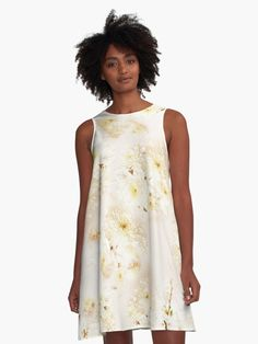 Lost in Antique White Flowers  A-Line Dresses by Gravityx9 Designs at Redbubble - Groups of pretty white flowers with tiny yellow centers. Placed on a light tan and creamy white background. • Also buy this artwork on apparel, stickers, phone cases, and more.