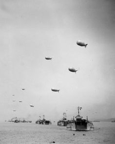 With barrage balloons against enemy aircraft flying overhead, a long line of LCts is crossing the English Channel, bringing men and material to the beachheads in France, during the Allied invasion of the Normandy, June 13, 1944. (AP Photo/Irvin Bede)