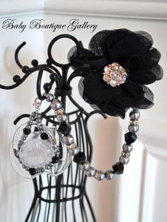 Baby Boutique 4-in-1 Beaded Pacifier Holder - Black Flower with Crystal Spacers. $21.99, via Etsy.