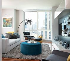 Modern High-Rise - Urban modern living room in teals and grays