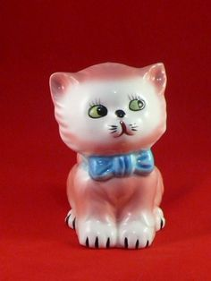 ADORABLE HAND PAINTED PINK CAT PLANTER from MID CENTURY JAPAN.  The cat has pink fur, a blue bow tie, and big green eyes.  He's really cute.