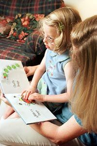 Information About Braille Information About Eye Conditions and Vision Photo of Girl with Mother Reading Braille Book.