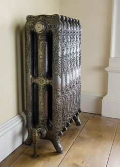 Rococco Cast Iron Radiator 780mm shown in full polish. What sets this radiator apart is the detail in the centre column.