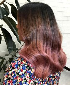 Soft Waves with Deep Pink Ombre: Here's another slightly more sedate take on the hair color trend, especially for ladies with naturally dark hair. With a deeper take on the rose gold hue combined with to-die-for waves, this look is about as glam as they come.