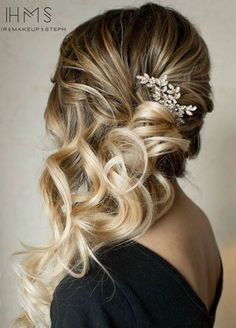 This look is ideal for a backless dress. You'll get the best of both worlds: you can show off the full fabulousness of your wedding dress, while sporting breathtaking swept curls. Hair & Makeup by Steph