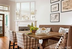 The large table with banquette and  chairs serves as a dining area when the couple entertains. The shorter side of  the banquette has an extra-deep cushion, making the corner a cozy spot to  recline and watch TV, read, or work on a laptop