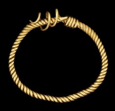 A Roman gold bracelet  Egypt, circa 2nd-3rd Century A.D. Composed of three substantial solid gold wires twisted into a spiral, tapering at each end to a single wire, overlapping and coiling around the other end of the bracelet for sizing, one partially unwound, 3in (7.7cm) diam; weight 74 grams