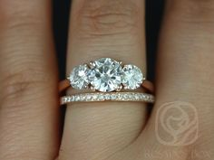 Tina 7mm & Hollie 14kt Rose Gold Round F1- Moissanite and Diamonds 3 Stone Wedding Set (Other metals and stone options available) by RosadosBox on Etsy https://www.etsy.com/listing/173255816/tina-7mm-hollie-14kt-rose-gold-round-f1