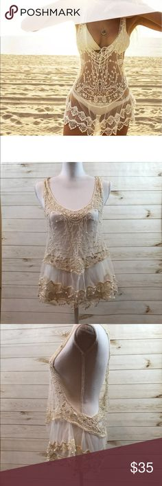 "Crochet Lace Beige Cover Up Crochet Lace Swimwear Beige Cover Up.       Available in S, M, L.                                     Small is approximately 24.5"" long 30.5"" Bust.  Medium is approximately 25.5"" long and 32"" bust                                                                     Large is approximately 26.5"" long and 34"" bust.                                                                     Brand new. Beige. Lace. Crochet.                Let me know if you have any questions…"