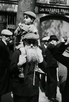 Robert Capa     Mayday, International Workers' Day March, Paris     1937
