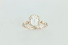 L.H. Rose Gold Halo Emerald Cut Engagement Ring (I think i'd like it better horizontally set)