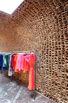 25,000 stacked brown paper bags surface the wall this NY store interior.