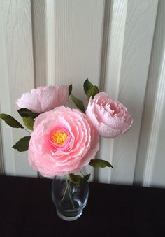 3 beautiful paper peonies. They are made from durable crepe paper. Each bloom is accented with several leaves. Please allow 3 business days for creation. Each flower is approximately 10 inches tall and 3-4 inches wide The small 5.5 inch vase can be included for an additional fee