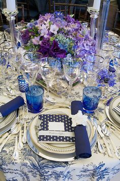 This couple chose to mix and match patterns with a solid blue napkin punctuated with a gardenia and a patterned dinner m...