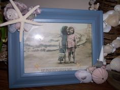 Blue Vintage Inspired Framed Print of Beach Girls in Coastal Decorated Pink and Ivory Sea Shell Frame with Starfish Sea Urchin