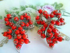 1920's Art Deco Rhodium Plated Coral Glass Bow Brooches