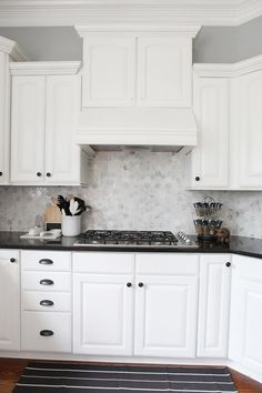 Kitchen: love the white cabinets with black countertops and gray contrast walls.