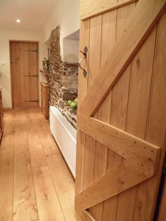 UK Oak Doors' Ledge & brace doors are the perfect addition for any barn conversion or countryside cottage. Our ledge and brace barn doors are available in various sizes and pre-sanded. Internal Cottage Doors, Internal Doors, Barn Conversion Interiors, Barn Conversion Kitchen, Solid Oak Doors, Cottage Renovation, Cottage Interiors, Interior Barn Doors, Interior Columns