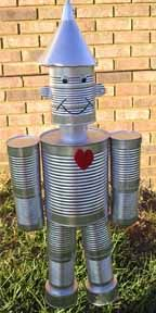 Tin Man for the yard or as a centerpiece for a party! Tin Can Man, Tin Man, Crafts For Kids, Arts And Crafts, Diy Crafts, Garden Whimsy, Origami Box, Scrap Metal Art, Tin Can Robots