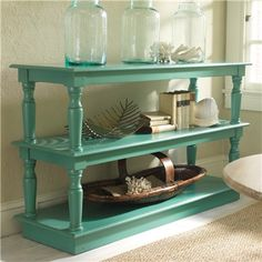 DIY Server / Sofa Table ~ 3 cheap thrift store tables. Paint your choice of color. Use the top from one as a base, then stack the remaining 2 tables. Easy! {and a lot cheaper than $ 2,500 bucks!)
