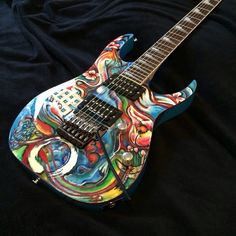budhist theme refinished ibanez rg 570 by christopher williams aka Guitar Painting, Ibanez, Mandolin, Cool Guitar, Painted Guitars, Bass Guitars, Cool Stuff, Hand Painted, Colorful